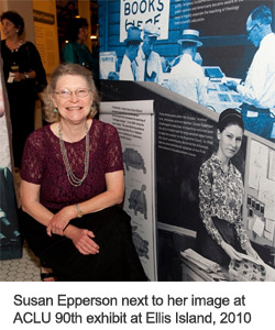 Susan Epperson stands next to her image at ACLU 90th exhibit, September 15, 2010, Ellis Island