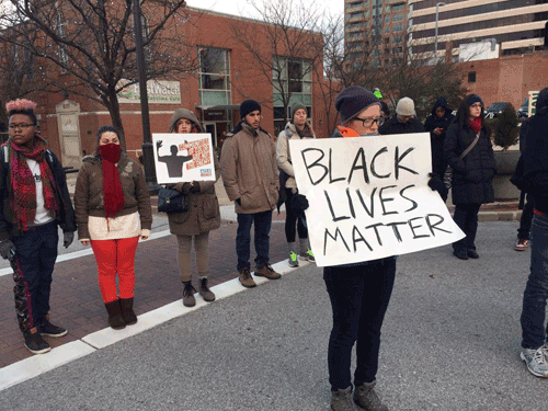 A moment of silence at the clergy-led action in Clayton, near Ferguson