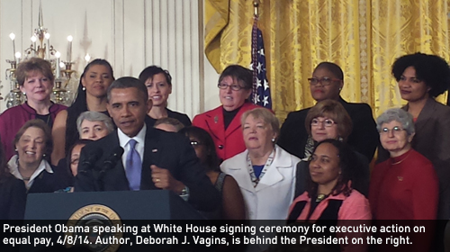President Obama speaking at White House signing ceremony for executive action on equal pay, 4/8/14. Author, Deborah J. Vagins, is behind the President on the right.