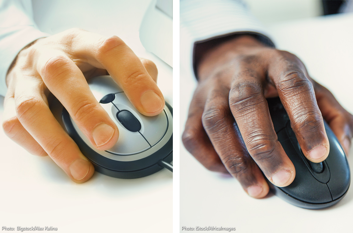 A white hand on a computer mouse side by side with a black hand on a computer mouse