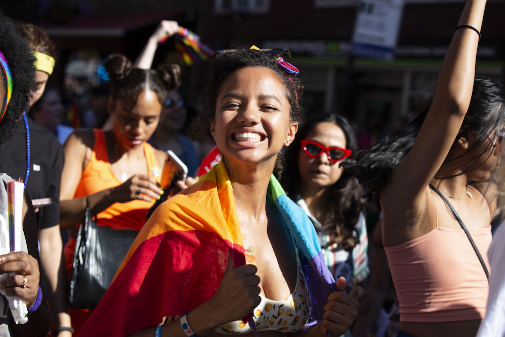 A smiling person at the pride parade