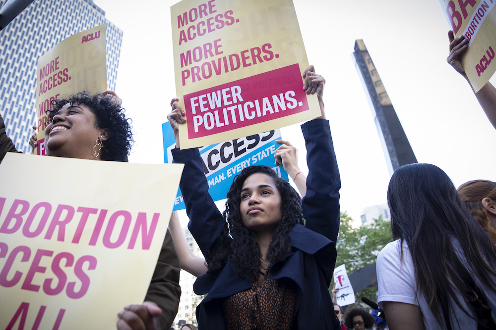 Women marching at an abortion access for all rally