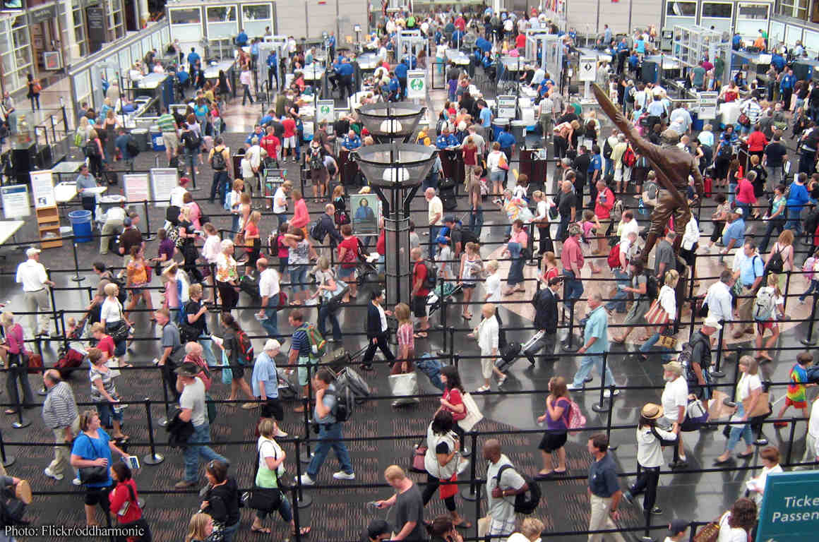 Crowded aiport line seen from above