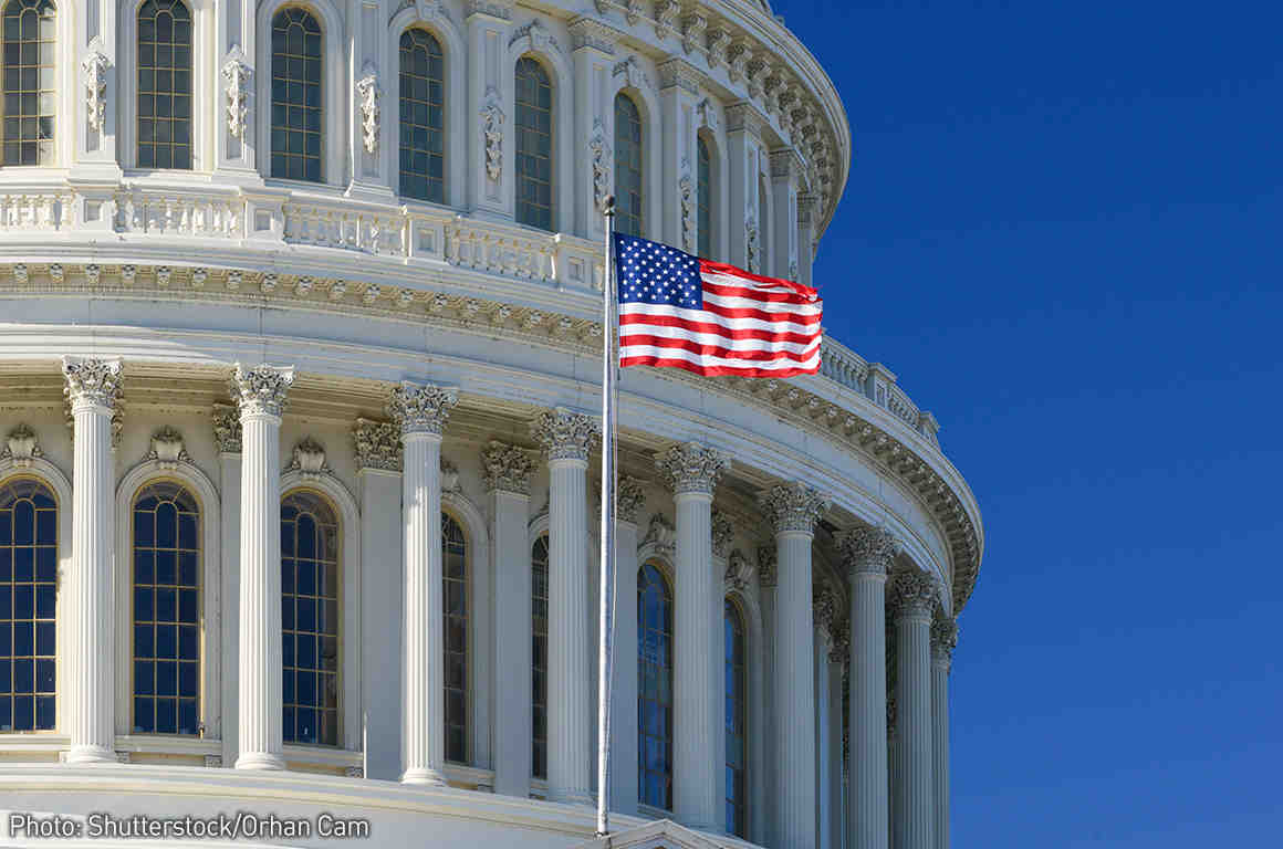 US Capitol Building with flag flying