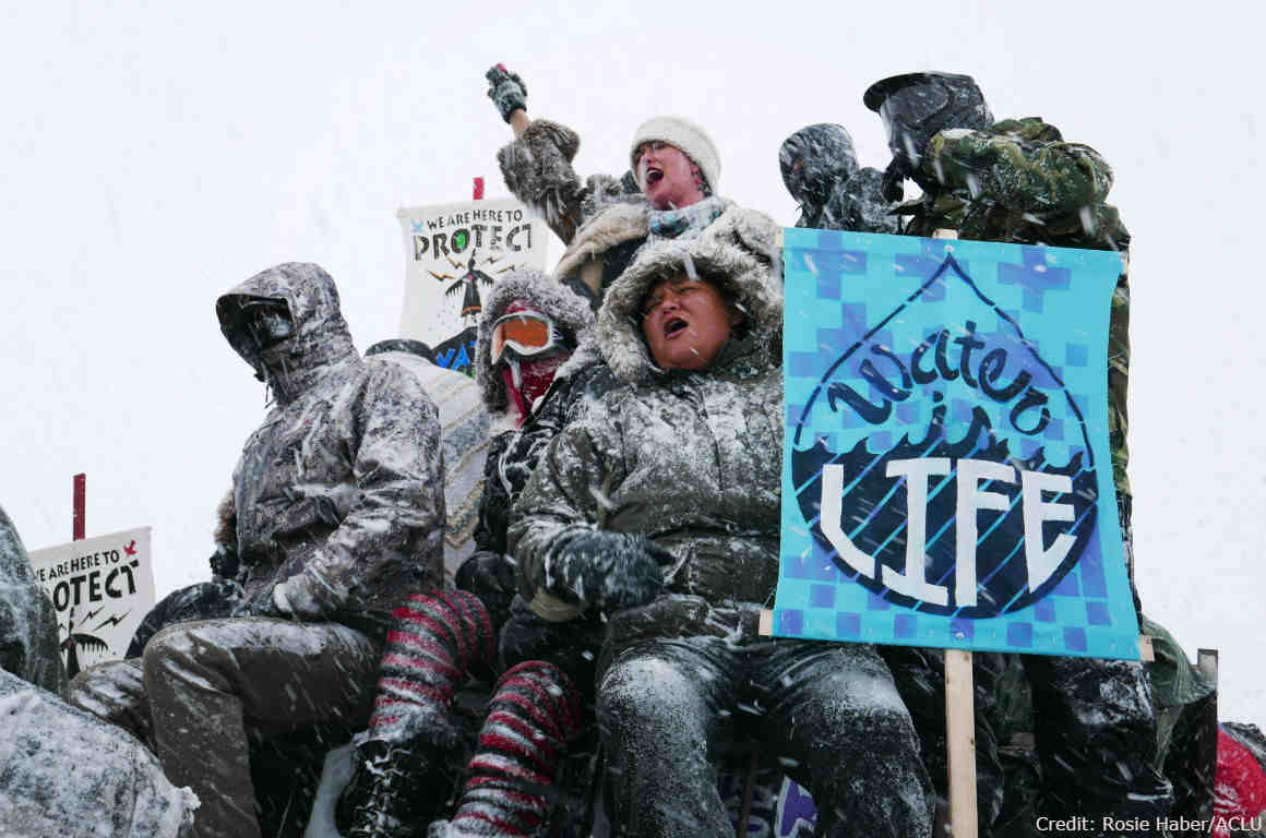 Water protectors and vets protest the Dakota Access Pipeline.