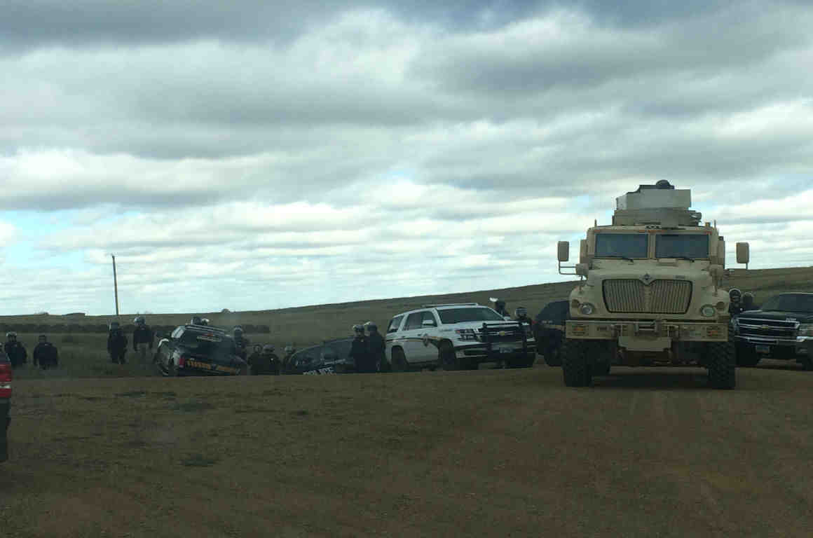Police car and military vehicle roadblock in Morton County, North Dakota