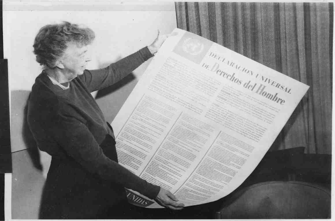 Eleanor Roosevelt holds a copy of the Spanish-language version of the Universal Declaration of Human Rights.