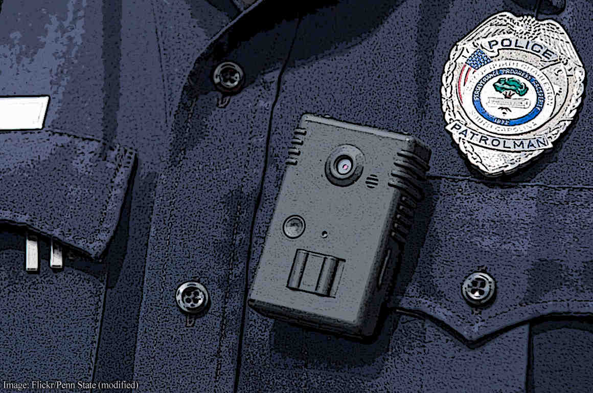 Closup of a body camera on the front of a police officer's uniform