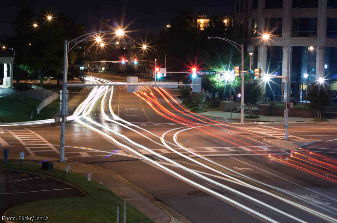 Photo of blurred car light trails at night