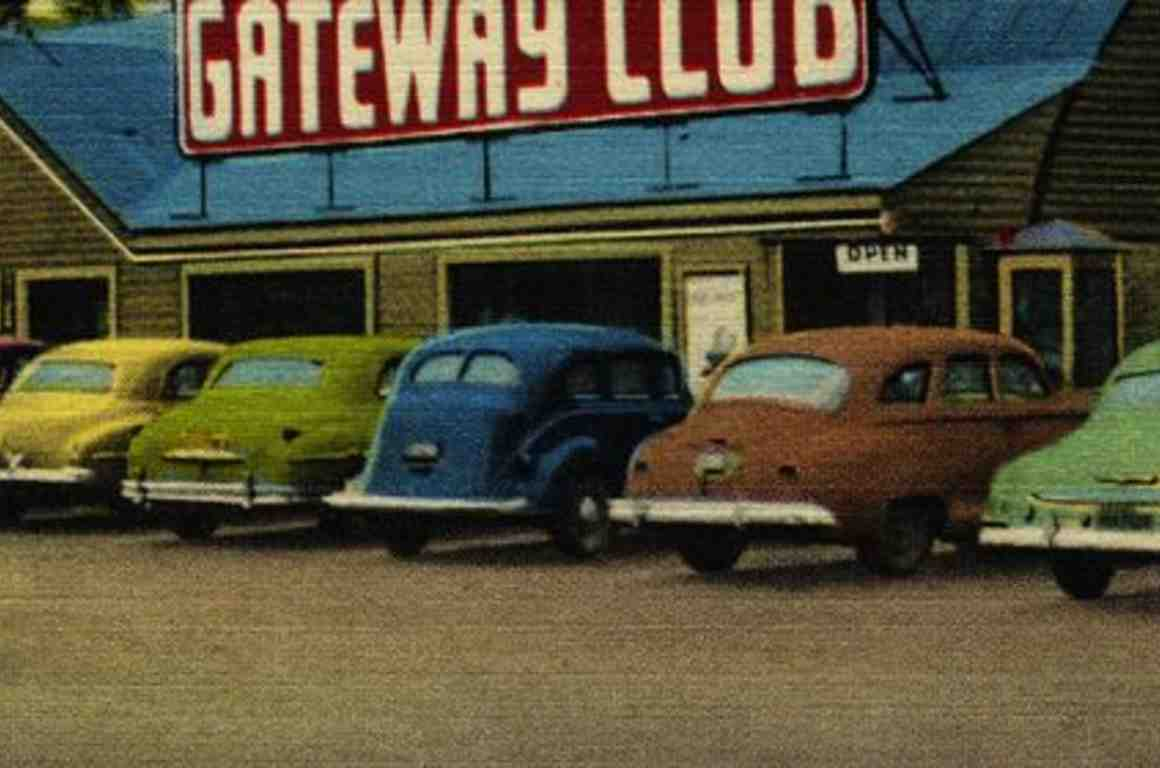 Old postcard of cars in parking lot