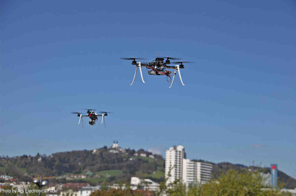 Two drones hovering in air