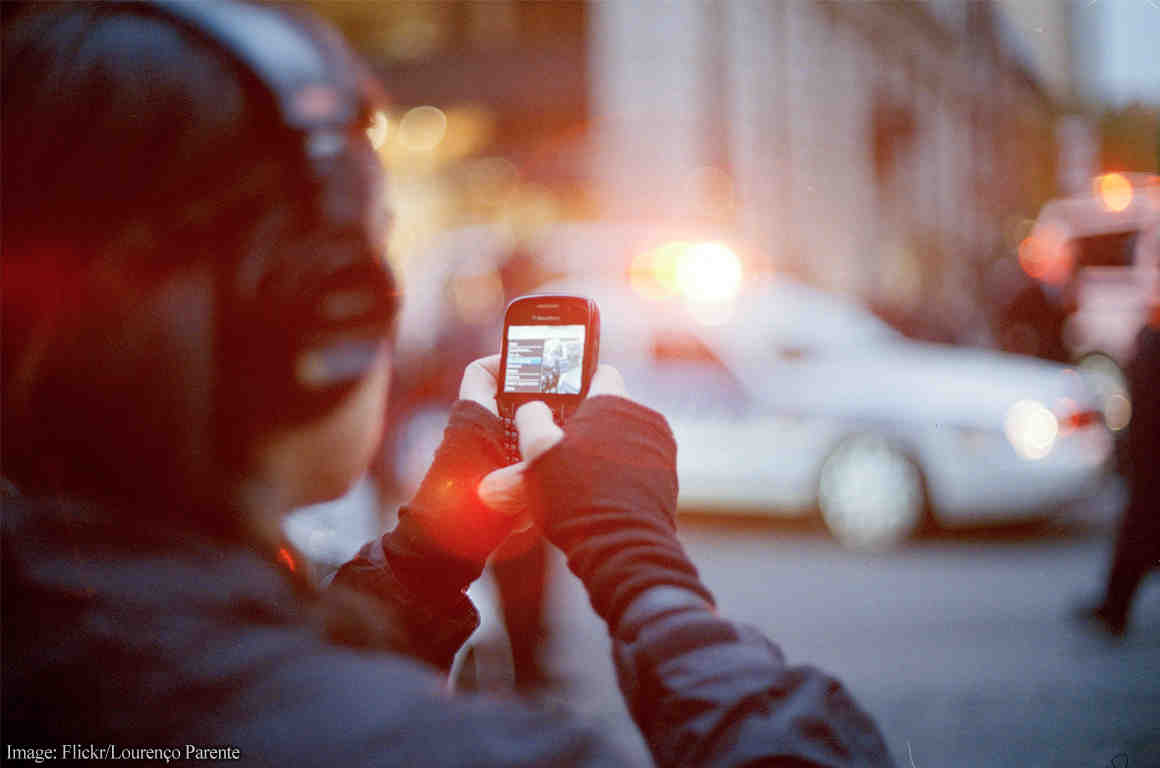 Person filming the police on phone