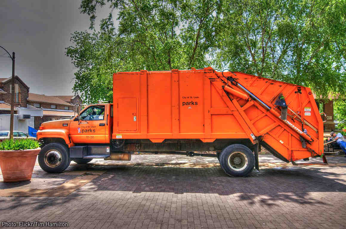 Big orange garbage truck