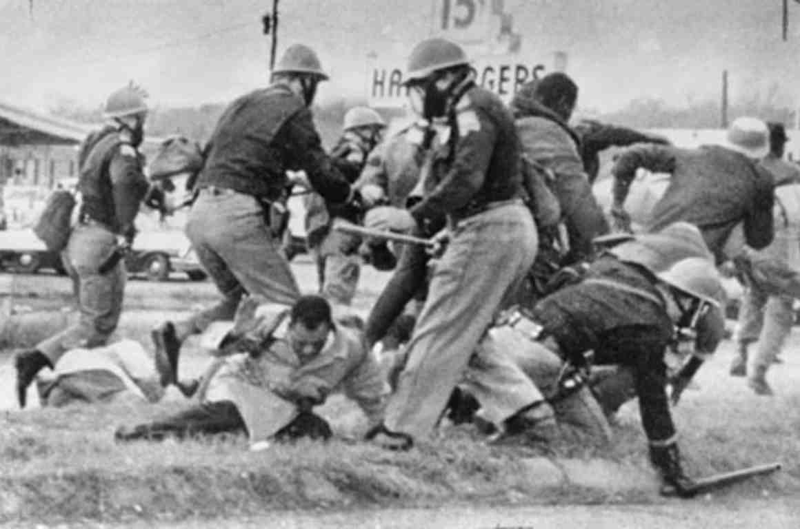 John Lewis being beaten by state troupers during Selma march