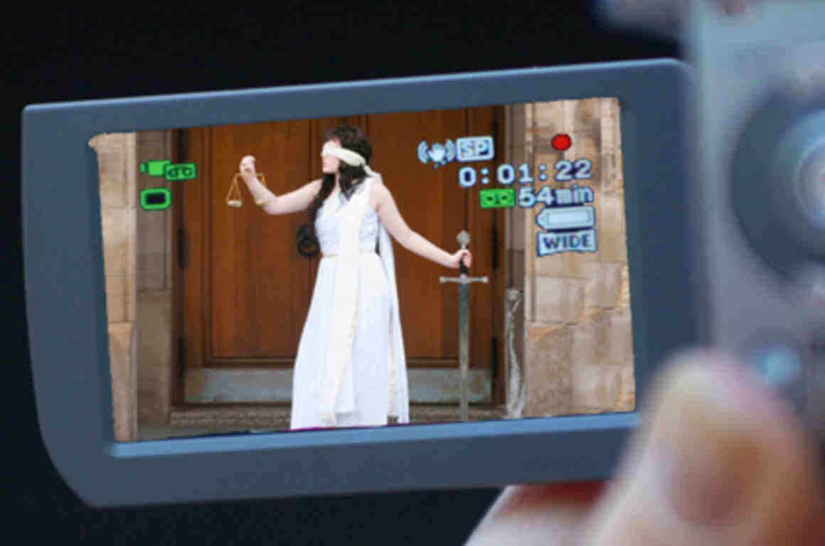 Image of Lady Justice on camcorder screen