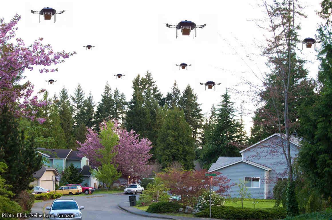 Neighborhood street with drones filling sky