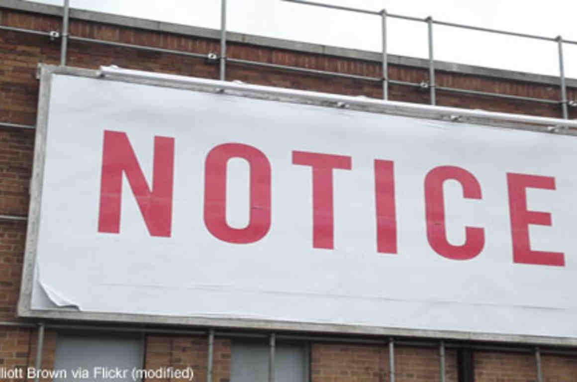 "Large billboard reading ""notice"""