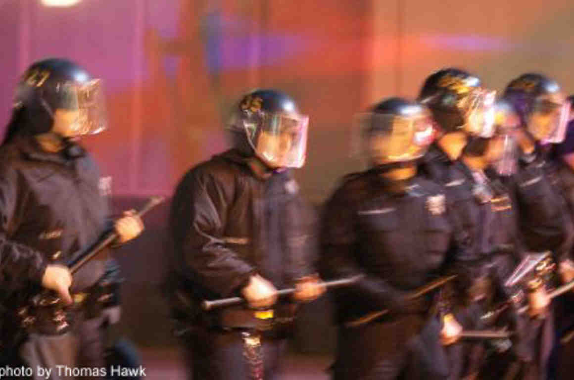 Photo of police standing with batons