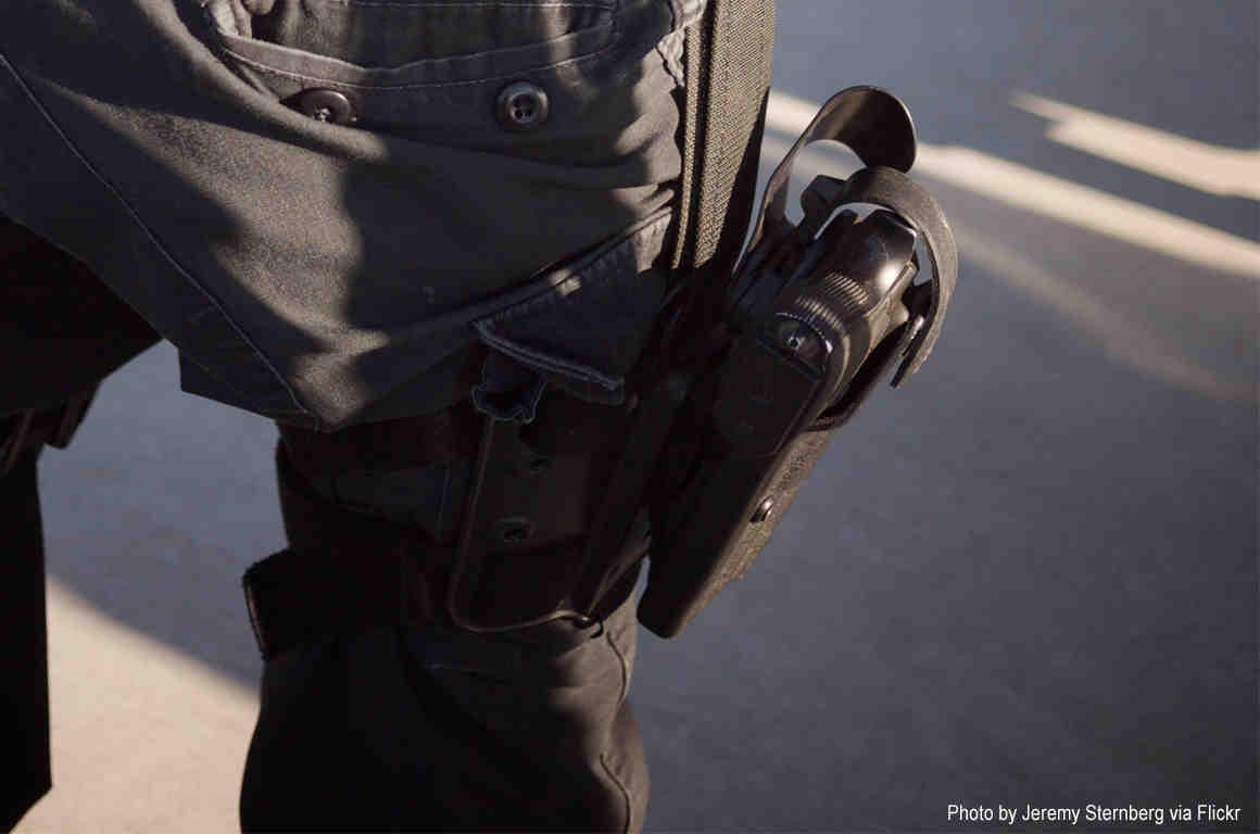 Closeup of gun on police officer's hip