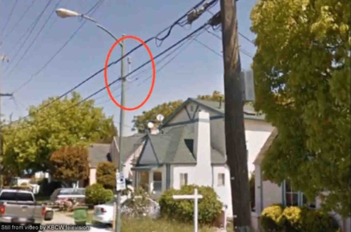 Photo of microphone on street pole next to house