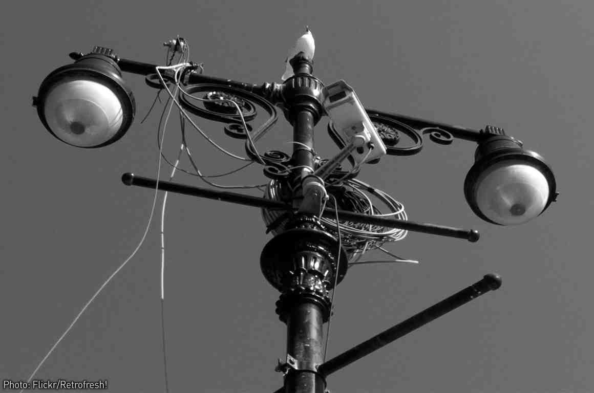 Eye-like streetlights with camera and wires attached