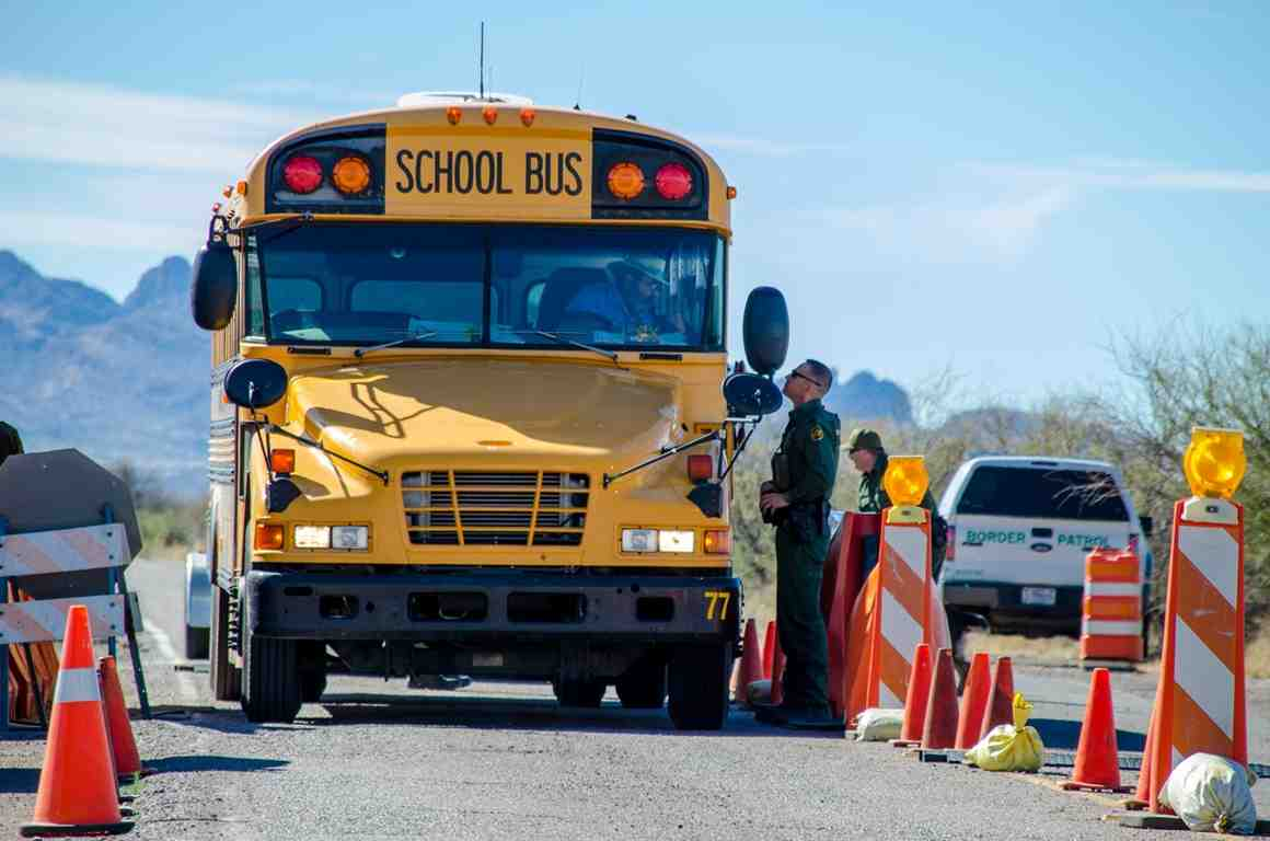 Border Patrol stops school bus at a checkpoint.