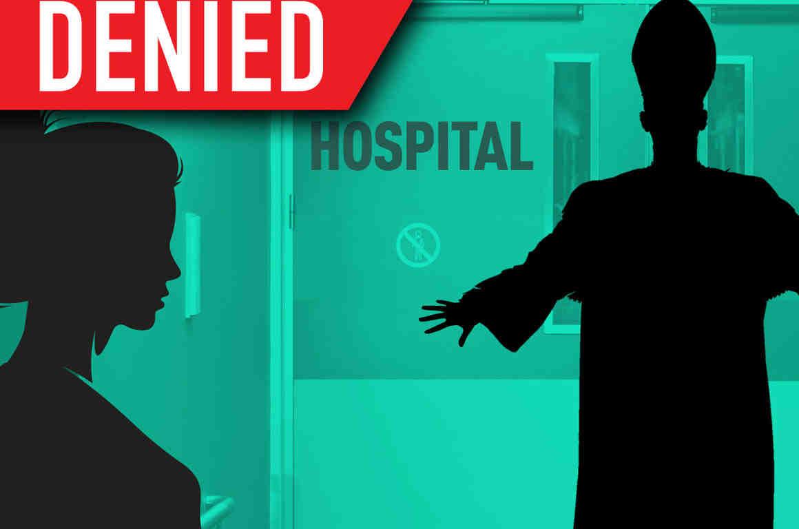 Bishop blocking hospital doors