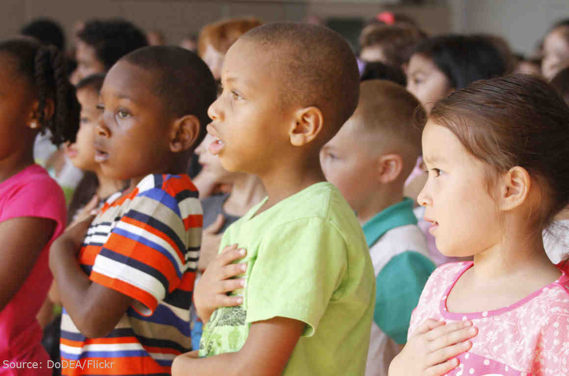 Students pledge allegiance to the flag.