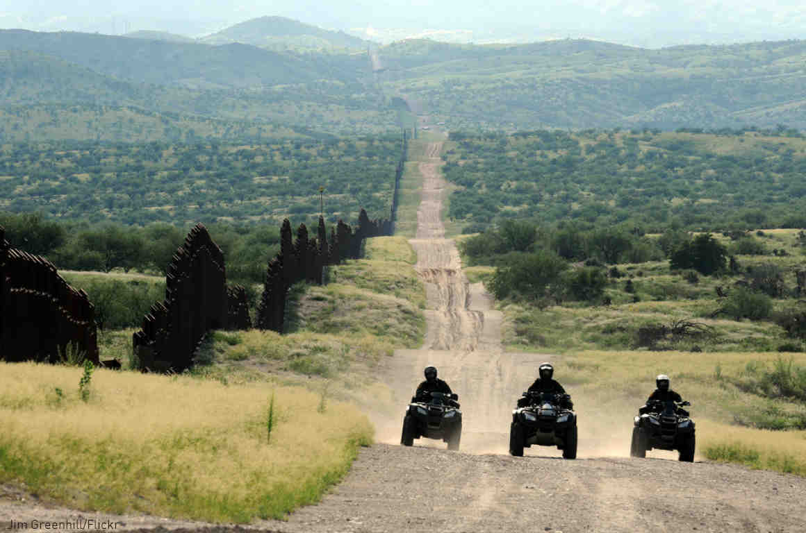 Border Patrol agents patrol U.S. border with Mexico near Nogales, Arizona.
