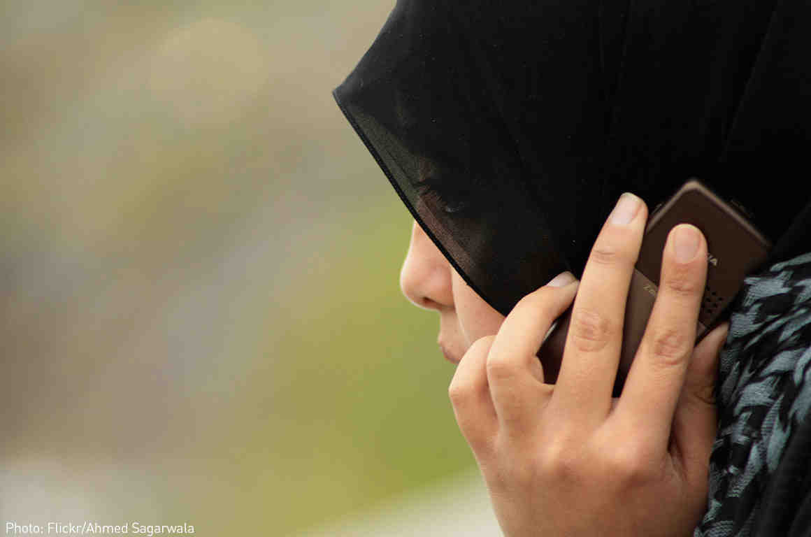 Woman wearing hijab on phone
