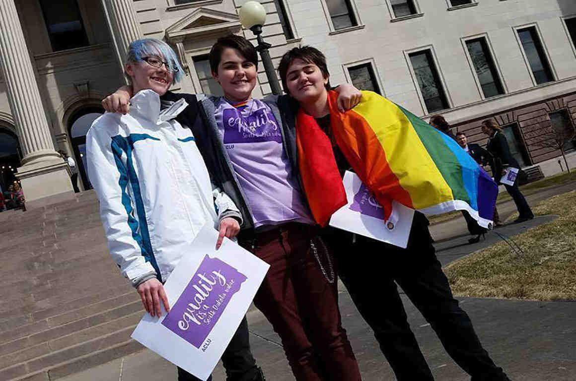 LGBT youth with flag