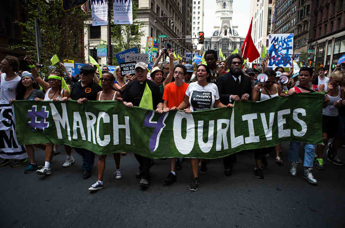 Crown marching with #March 4 Our Lives sign