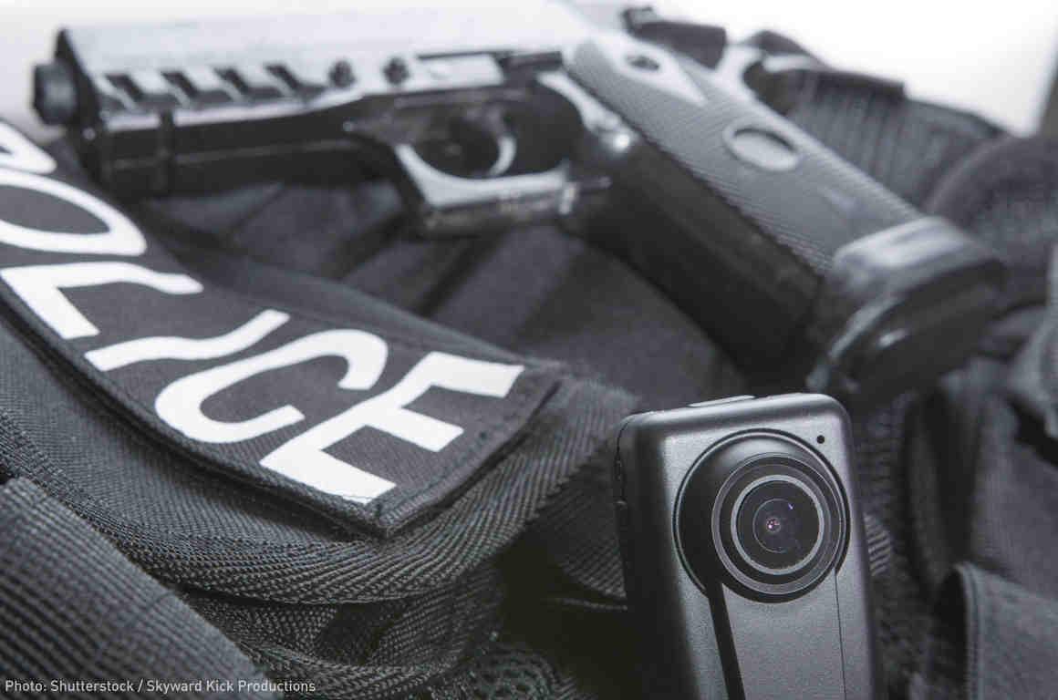 Police vest, body camera, and gun