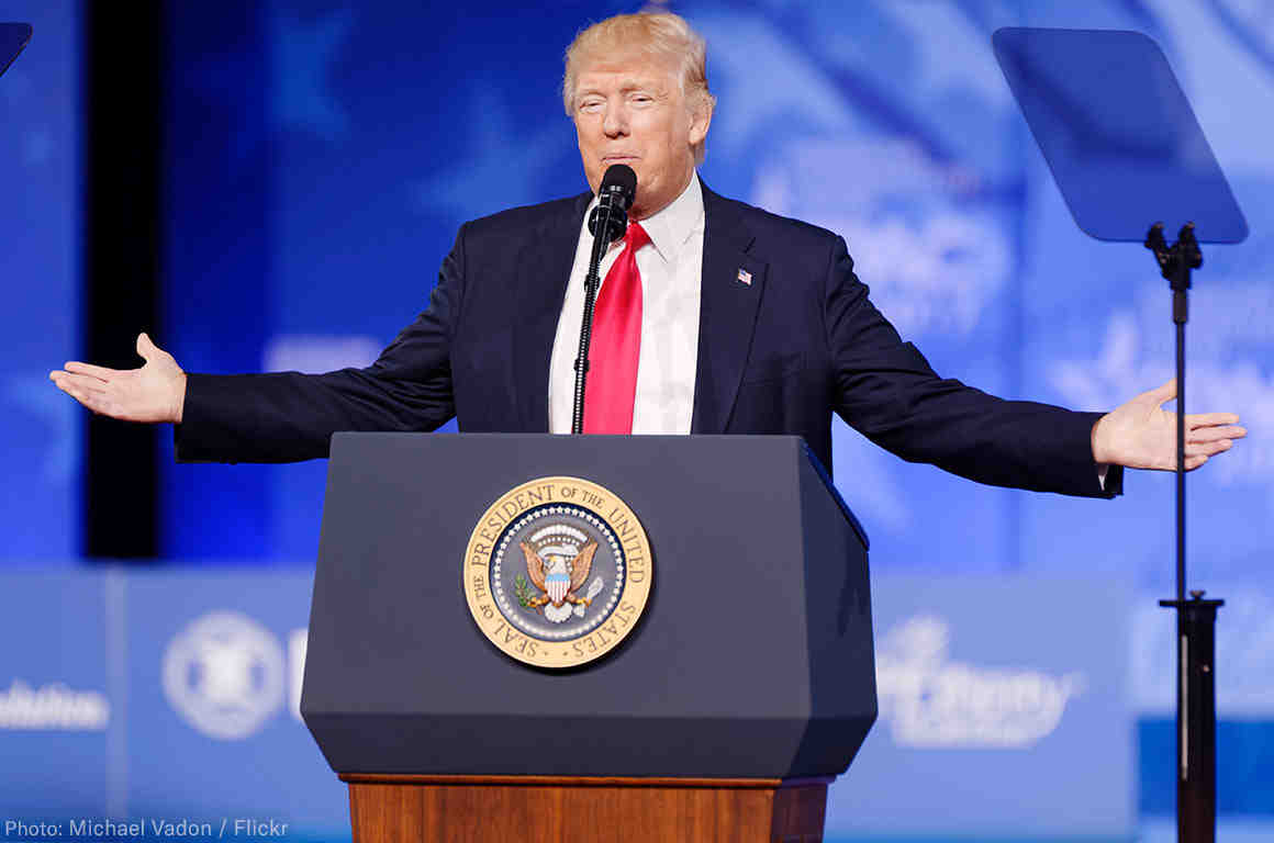 President Trump at Podium With Arms Spread