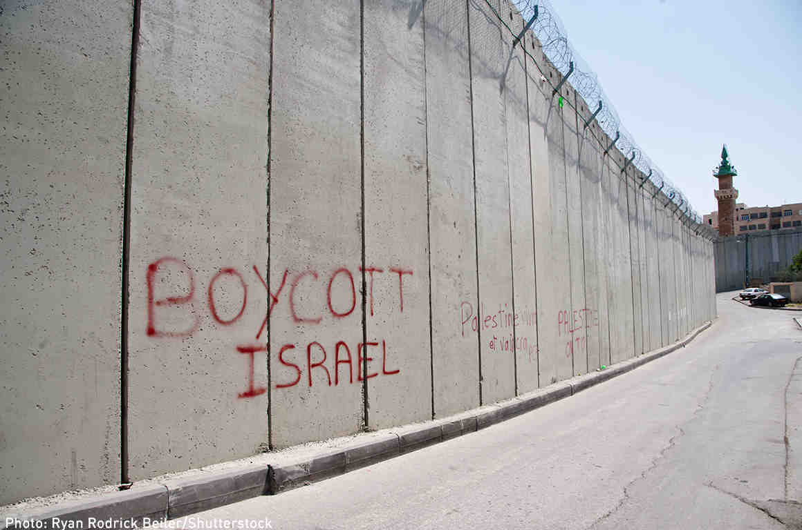 "Graffiti on the Israeli separation wall dividing the East Jerusalem neighborhood of Abu Dis reads, ""Boycott Israel"""
