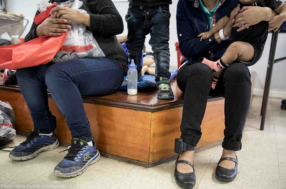 Immigrant women and children at a holding center with ankle monitors