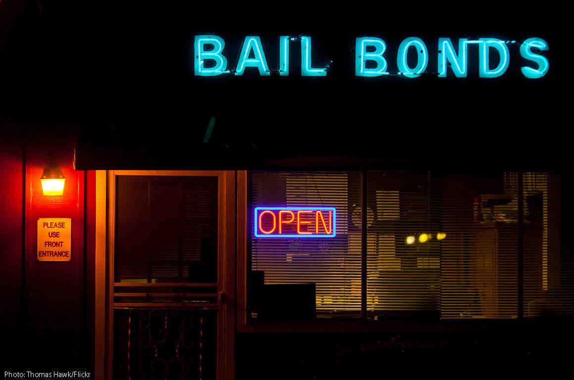 Neon bail bonds sign outside building