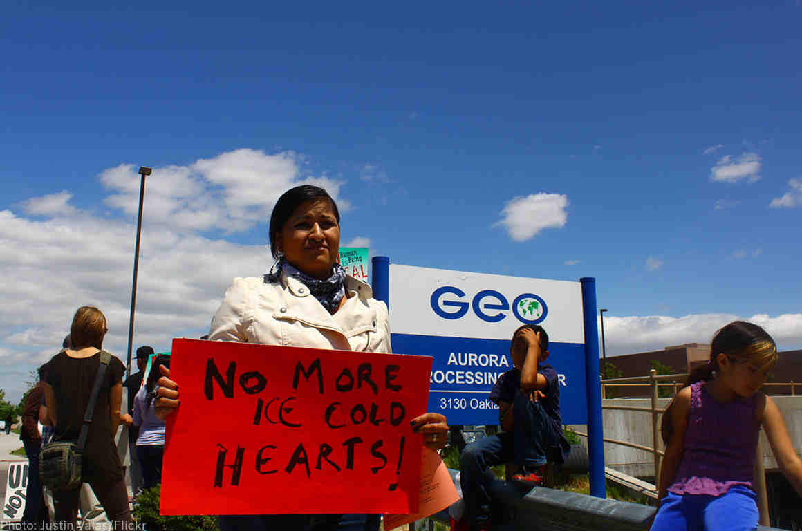 Protester in front of GeoGroup offices