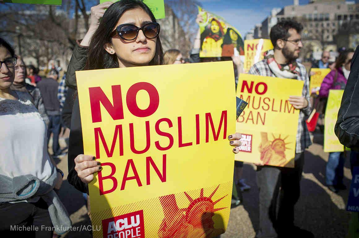 """""""No Muslim Ban"""" signs at a rally"""