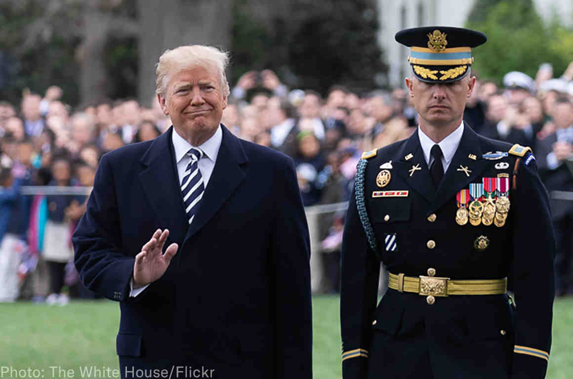 Trump and a member of the military