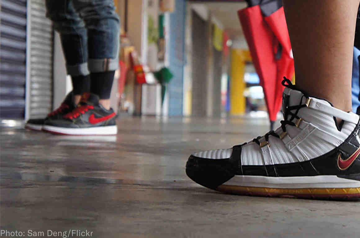 Wearing Nike sneakers