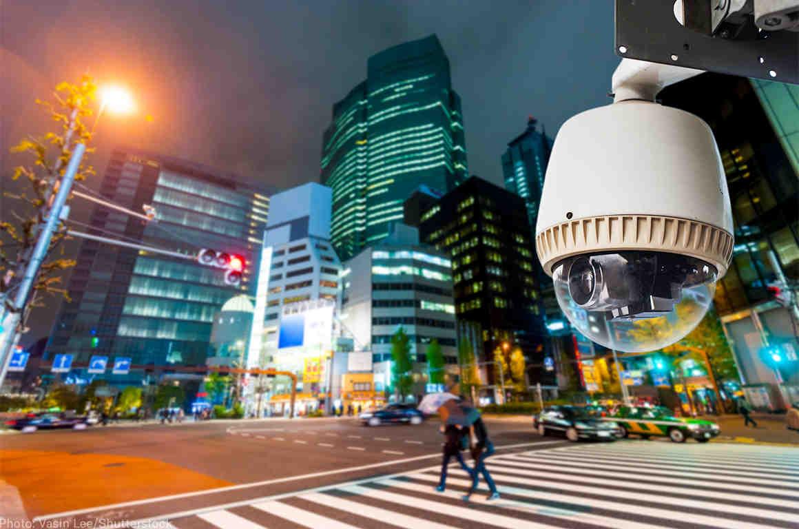 Surveillance camera on a city street at night