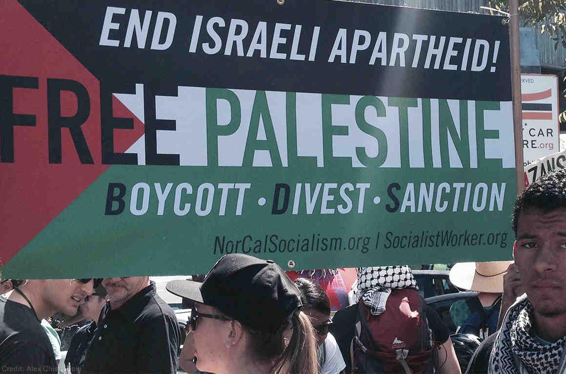 Protest with Free Palestine Boycott Divest Sanction Banner