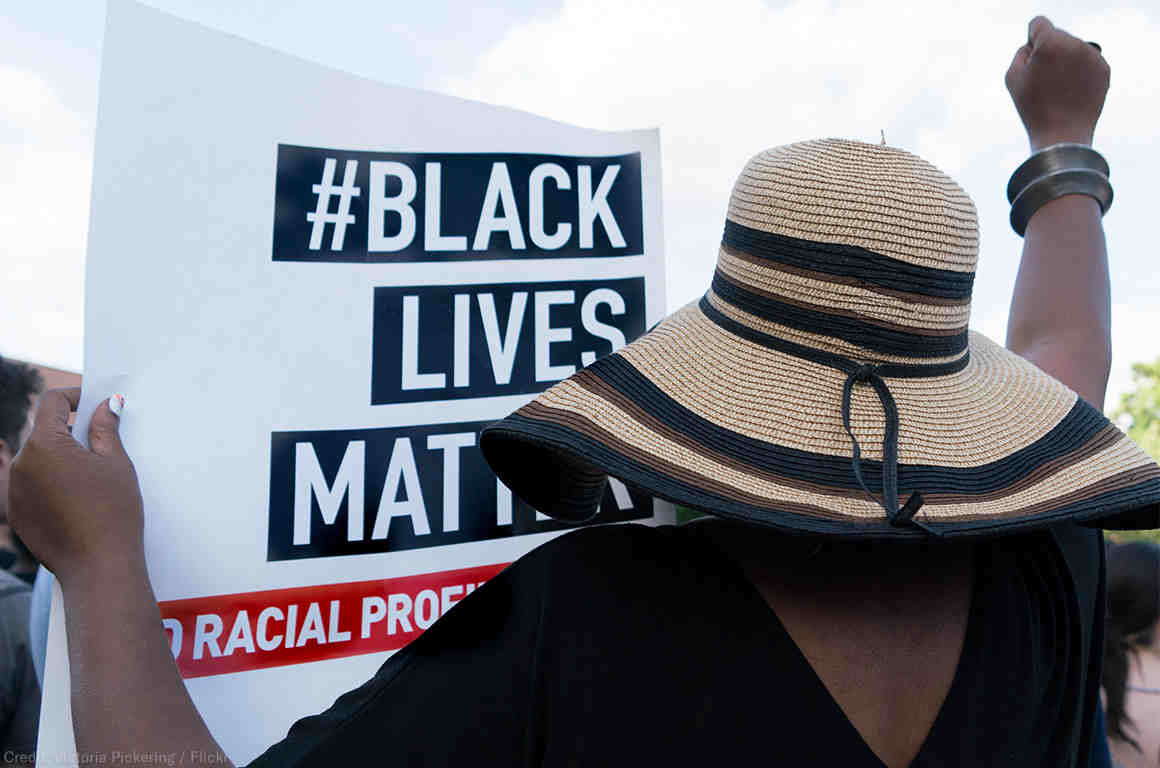 A protester holding a Black Lives Matter sign