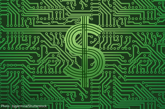 Dollar sign over computer chip