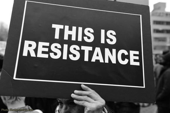 "Sign: ""This is resistance."""