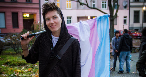 Trans Individual with Trans flag