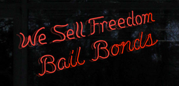 """We Sell Freedom Bail Bonds"" in neon lights"