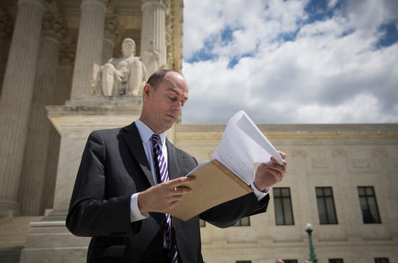 James Esseks on the steps of the Supreme Court