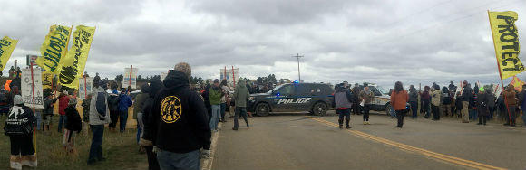 Peaceful water protectors demonstrated in front of a police roadblock preventing them from driving on public roads to pray at one of the Dakota Access construction sites on October 3.